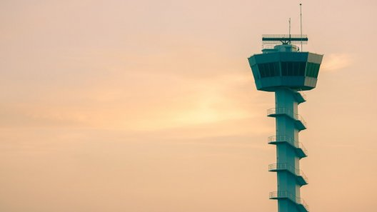 Airport control tower at dusk