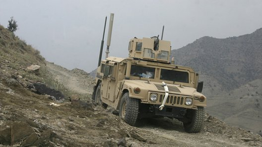 Military vehicle in desert conditions